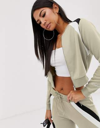 Couture The Club Club cropped paneled tracksuit sweater with logo sleeve detail