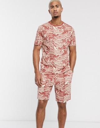 Asos DESIGN lounge pyjama tshirt and short set in souvenir all over print