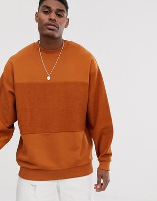 Asos DESIGN oversized sweatshirt with reverse panel in rust