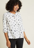 T365-01 This ivory blouse is loyal in its loveliness and obedient in its originality. A ModCloth exclusive touting a Peter Pan collar trained atop a buttoned keyhole, and black-and-grey illustrations of all sorts of pups, this 3/4-sleeved top is soon to be your b