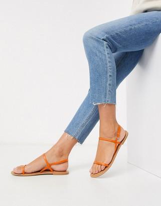 ASOS DESIGN Fuse leather flat sandals in orange