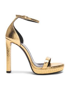 Saint Laurent Hall Ankle High Heels in Gold   FWRD