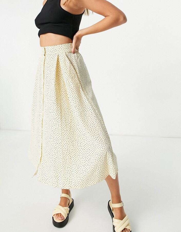 Monki Sigrid recycled button through midi skirt with in beige spot print