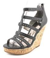 Carlos by Carlos Santana Maiko Open Toe Synthetic Wedge Sandal.