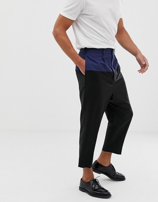 ASOS DESIGN drop crotch tapered smart pants in black wool with techy cut and sew