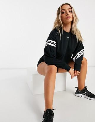 Nike Pro Training cropped sweatshirt with logo taping in black