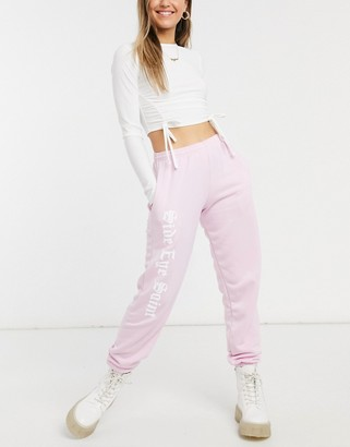 Skinnydip x Jade Thirlwall trackies with side eye slogan in pink co