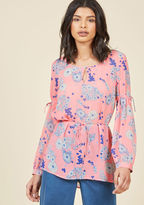 Mct1229 After finalizing your itinerary and packing your suitcase, all that's left to do is slip into this sheer blouse from our ModCloth namesake label! The neckline keyhole, blue-and-white florals, and thin waist tie of this pink top ensure style on arrival, wh