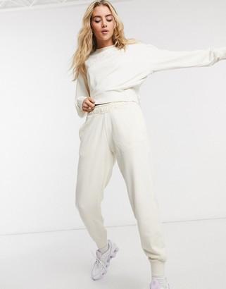 Nike washed logo sweatpants in cream