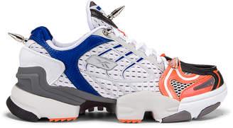 Vetements Spike Runner 400 Sneakers in Fluo Orange | FWRD