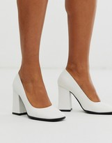 Truffle Collection square toe pointed block heeled shoe in white