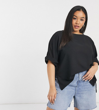 ASOS DESIGN Curve oversized woven tee with roll sleeve in black