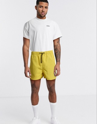 The North Face MOS shorts in yellow