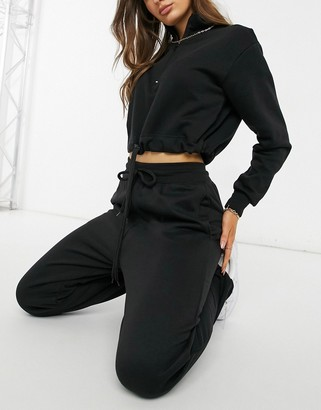 Femme Luxe cropped zip detail hoodie and fitted trackies co-ord in black
