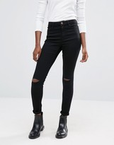 Asos Ridley Skinny Jeans In Clean Black With Displaced Ripped Knees