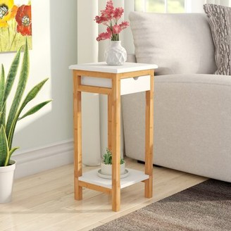 Ebern Designs Wellston End Table with Storage Table Top Color: White