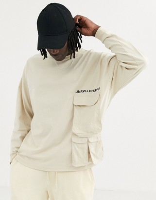 ASOS Unrvlld Supply heavyweight oversized long sleeve t-shirt with utility pocket embroidery