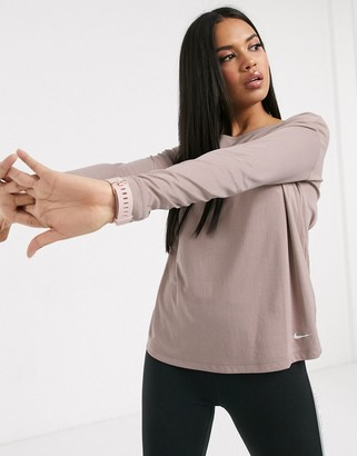 Nike Training Pro long sleeve top with cross back in smokey mauve-Purple