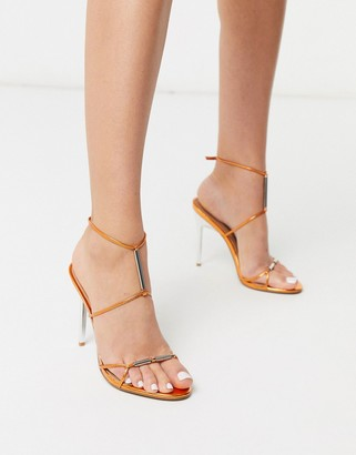 ASOS DESIGN Now metal trim t-bar heeled sandals in copper metallic