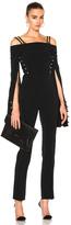 David Koma Oversized Loops & Metal Balls Cropped Jumpsuit in Black.