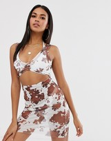 Asos Design DESIGN bodycon jersey beach dress in cow print with cut out detail