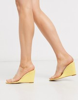 Glamorous wedge with clear upper in pastel yellow