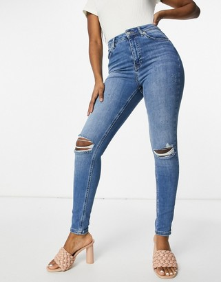 NA-KD organic cotton high waist ripped skinny jeans in mid blue