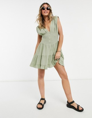 ASOS DESIGN shirred waist button front tiered mini sundress in crinkle in khaki