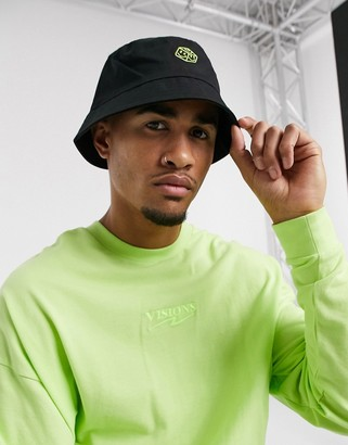 ASOS DESIGN bucket hat in black cotton with green embroidery