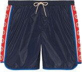 Thumbnail for your product : Gucci Nylon swim shorts with logo stripe