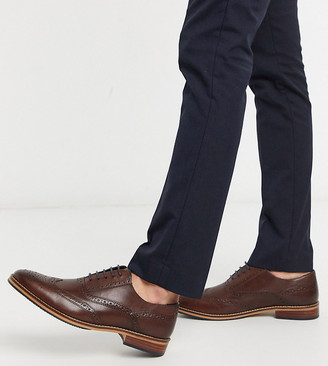 ASOS DESIGN Wide Fit brogue shoes in brown leather with natural sole and color details