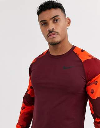 Nike Training long sleeve baselayer top with camo sleeves in burgundy-Red