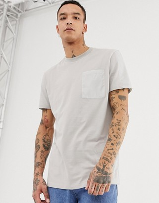 Asos DESIGN relaxed longline t-shirt with contrast pocket and panels in woven fabric in gray