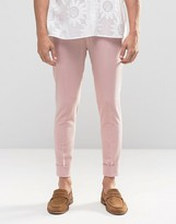 Asos Super Skinny Trousers In Pink Jersey With Turn Up