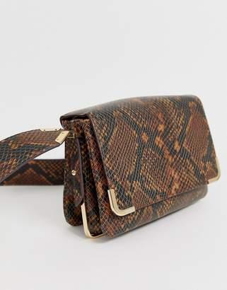 Aldo Qirassa snake print crossbody bag with gold detailing in brown