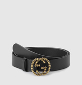 Gucci black leather belt with studded interlocking G buckle