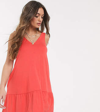 Asos DESIGN Petite concealed pocket mini dress with tiered hem in coral