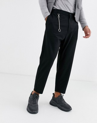 Bershka carrot fit trousers with chain in black