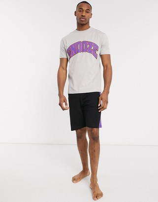 Asos DESIGN pyjama short and tshirt set with snooze slogan