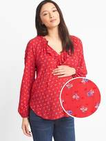 Maternity floral swiss-dot ruffle top