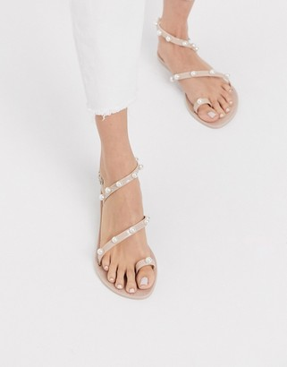ASOS DESIGN Flaunt pearl jelly flat sandals in pink