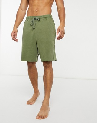 ASOS DESIGN lounge pyjama shorts with raw hem in khaki wash