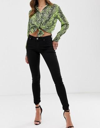 Asos Design DESIGN Lisbon mid rise skinny jeans in clean black in ankle grazer length