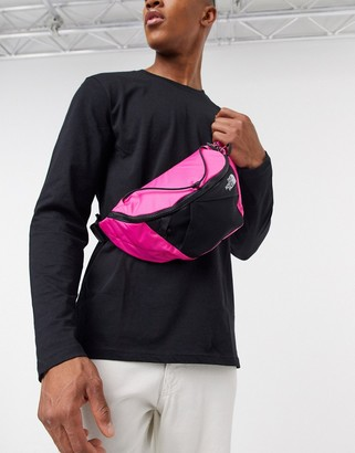 The North Face Lumbnical small bum bag in dark pink