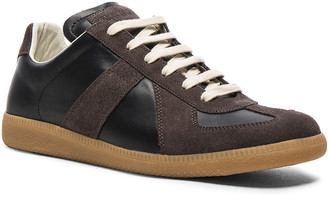 Maison Margiela Replica Sneakers in Black | FWRD
