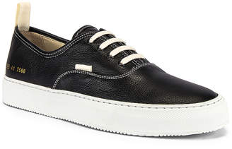 Common Projects Four Hole in Leather Low Sneaker in Black & White | FWRD