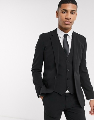 ASOS DESIGN super skinny suit jacket in four way stretch in black
