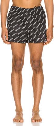 Vetements Swim Shorts in Logo All Over | FWRD