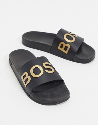 HUGO BOSS Bay sliders in black and gold