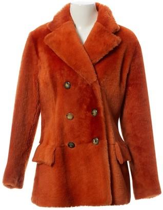 Gucci Orange Shearling Coats